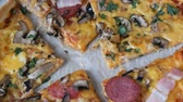 fattening : Many pieces of the pizza with different fillings, olives, chicken, mushrooms, cheese, bacon, salami, greens