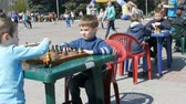 lovagi torna : April 21, 2018 - Kamenskoye, Ukraine: Children play chess in street. Street Chess Tournament outdoor