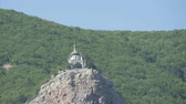 multicopter : View on a beautiful Foros Orthodox Church, which stands on top among the rocky and green Crimean mountains