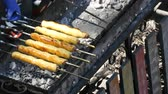mussarela : The sausage in the dough is roasted on grilled skewer, fast food, street food Vídeos