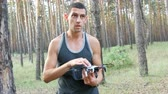 multicopter : Cute tall man launches drone or quadrocopter in the woods