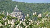 zmartwychwstanie : Orthodox Church in Foros stands on a mountain, against a backdrop of flowering chestnuts
