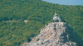 retro revival : View on a beautiful Foros Orthodox Church, which stands on top among the rocky and green Crimean mountains