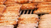 sauerkraut : Lots of delicious grilled Nuremberg German sausages grilled in row on the Christmas market Stock Footage