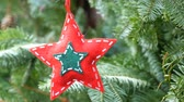 koraliki : Christmas tree toy in the shape of star of red color from wool fabric decorated with glass beads that hangs on a branch