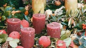 sněhulák : Many large multi-colored Christmas thick wax candles standing in holly and spruce. The spirit of Christmas and the new year. Scenery for a holiday in the market on eve of Christmas