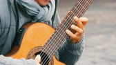 guitar player : Nuremberg, Germany - December 1, 2018: Street guitar professional playing skillfully playing acoustic guitar in street. Guitarist hands playing a wooden guitar Stock Footage