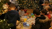 papai noel : Nuremberg, Germany - December 1, 2018: Kids get ready for Christmas and New Year making handmade crafts Christmas tree toys. Children have fun at mall or shopping center. Stock Footage