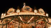 eğlence peşinde : Nuremberg, Germany - December 1, 2018: Fascinating flashing lights dark night sky illumination of vintage merry go round fair carousel ferris wheel in christmas market