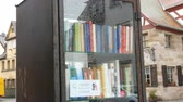 yazılı : Furth, Germany - December 3, 2018: The world famous bookcrossing movement in Germany. Special shelves with books written in German, which stands on the street.