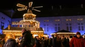 imperial : Munich, Germany - December 2, 2018: Christmas village market in the imperial palace of residence. Antique Christmas mill in the lights, in which there are wooden figures depicting Christmas. Stock Footage