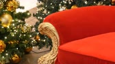 papai noel : Part of Red chair of Santa Claus or St. Nicholas near christmas tree at the mall. Christmas decor shopping center Stock Footage