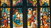 potřísněný : Beautiful ancient multi-colored stained-glass windows of old German church with biblical themes Dostupné videozáznamy