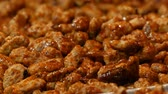 glaze : Traditional Christmas Roasted sweets Nuts in Glaze on the Storefront close up view. Germany Christmas Market Stock Footage