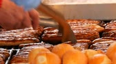 sauerkraut : Christmas market, national German sausages are grilled, next to buns. Womens hands turn Nuremberg sausages with help of special tweezers Stock Footage