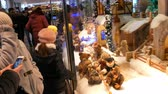 recheado : Munich, Germany - December 2, 2018: The famous Munich showcase with moving toys on the Marienplatz, which opens only for the Christmas holidays. Crowd of adults and children look on it.