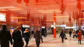 эскалатор : Munich, Germany - December 2, 2018: Underpass at the main metro station Munich, Marienplatz. Modern stylish design of the red ceiling, which reflects the pedestrians. Стоковые видеозаписи