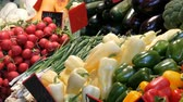 berenjenas : Various vegetables on the counter of the grocery market. Healthy food, fiber, diet, inscription in Hungarian.
