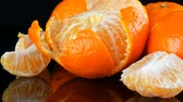 crop loss : Fruits mandarin on a black background on a mirror surface Stock Footage