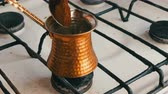 authentisch : Teaspoon puts black ground coffee in a copper Turk which stands on white gas stove Videos