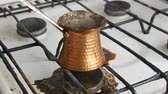 drinkwater : Boiled away runaway ground black coffee in a copper turk on white gas stove
