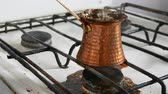 gravür : Boiled away runaway ground black coffee in a copper turk on white gas stove