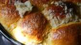 mama : Freshly baked roast dough on baking sheet only from the oven. Hot steam on Ukrainian national dumplings with garlic. Homemade baking