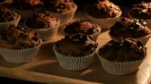 hotéis : Delicious muffins in paper molds are cooked in oven close up view