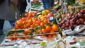 bazar : Buyers buy products. Vegetable market in a big city. Huge selection of various vegetables and fruits. Healthy fresh organic vegan food on the counter. Price tags in German. Vidéos Libres De Droits