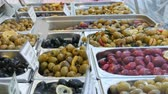 colorful backgrounds : Market counter with various stuffed olives of green, red, black. Vegetarian food