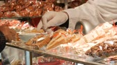 Christmas stall with sweets. The seller sells sweets. Buyer pays for purchase Stock Footage