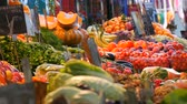 Vegetable market in a big city. Huge selection of various vegetables and fruits. Healthy fresh organic vegan food on the counter. Price tags in German. Stock Footage