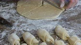 fırın : Female hand cuts the dough with a knife. Raw croissants in a row. Homemade sweet pastries. Jam, the dough, made by woman hand at home kitchen