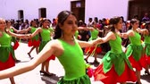 equador : Cuenca, Ecuador  November 3, 2016 - Women in green and red dresses dance in Cuenca Independence Parade 2016
