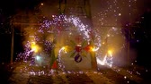serin : Cuenca, Ecuador  June 4, 2015 -Slow motion spinning sparklers on fireworks castle during Corpus Cristi celebration Stok Video