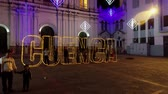 celebrando : Cuenca, Ecuador - December 31, 2018 - Drone rises, shows CUENCA in outline with people standing inside on New Years Eve
