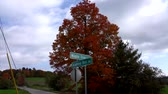 ölen : Time Lapse - Clouds Fly During Fall Colors of Vermont Over Intersection of Maple Hill and Academy Hill. Stok Video