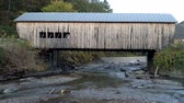 Мичиган : Aerial Drone - Stream Runs Under Weathered Covered Bridge in Fall in Vermont