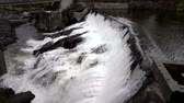 водослива : Slow Motion - Water Rushes Over Small Hydro Electric Dam in Vermont 4K