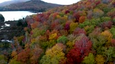 ölen : Aerial Drone - Decend From High Altitude Over Lake And Hill Showing Peak Colors in Fall in Vermont Stok Video