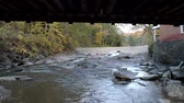 michigan : Aerial Drone - Fly Under Weathered Covered Bridge in Fall in Vermont