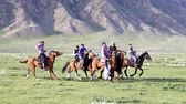 paardrijden : Issyk Kul, Kyrgyzstan - 20170529 - Buzkashi players skirmish with goat carcass