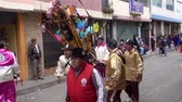 ziyafet : Latacunga, Ecuador  -  20180925  -  Ashanguero in White Carries 250 Pounds of Feast on His Back in Mama Negra Parade