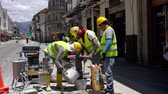 balde : Cuenca, Ecuador  -  20180920  -  Workers Mix Grout