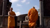 равновесие : Polonnaruwa, Sri Lanka - 2019-03-23 - Monks On Tour 8 - Up Stairs Past Buddha Statue.