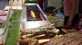 krokodyl : Chiang Mai, Thailand - 2019-03-15 - Aligator Meat is Cooked at Market - Basted Side View.