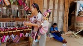 bugiganga : Mae Saiong. Thailand - 2019-03-11 - Woman With Baby On Back Tried To Sell Her Bead Wares. Vídeos