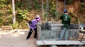 barış : Mae Saiong. Thailand - 2019-03-11 - Building New Shrine - Hammering Concrete Form.