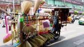метла : Bangkok, Thailand - 2019-03-17 - Market Vendor of Brushes and Brooms Rides by on Motorcycle Cart.
