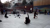 gimnasia : Valparaiso, Chile - 2019-07-13 - Students Practice Juggling and Hoops in Courtyard. Archivo de Video